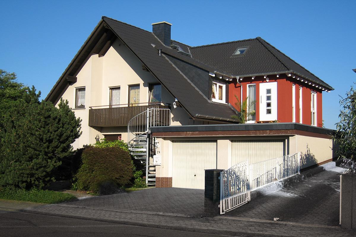 Aufstockung Anbauten Hessenhaus